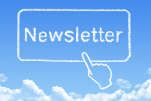 Finger pointing to Newsletter button in the clouds